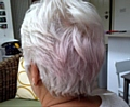 FROM white to pink . . . the 61-year-old believes the colour change in her hair was caused by using her new red bedding