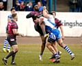 TRY-SCORER . . . Jamel Chisholm (centre) touched down for Oldham.