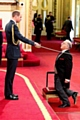 ARISE, Sir Norman... Norman Stoller is knighted by the Duke of Cambridge at Buckingham Palace.