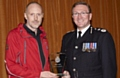 WELL done . . . Mick Nield is presented with a Chief Constable's Commendation by Ian Hopkins