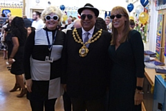 Woodhouses Primary head teacher Rachael Bentham (left) gets into the 60s spirit alongside the Mayor of Oldham Cllr Javid Iqbal (dressed as Kojak) and Ashton MP Angela Rayner