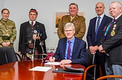 Sir David Dalton, chief executive of the Northern Care Alliance, signing the covenant