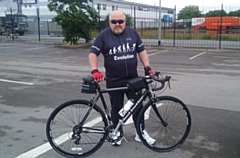 Mike Roberts pictured with his trusty bike