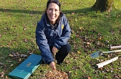 MP Debbie Abrahams inspecting one of the saplings in Alexandra Park