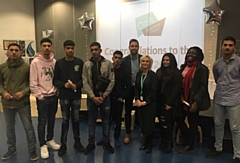 Ben Smith (centre) pictured with a group of Oasis Academy students during his visit