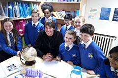 Pictured with Professor Brian Cox are Luca Read, Ameera Alam, Isaac Collier, Millie Griffiths, Rohaan Zia, Kyra Atkinson, Roni Etugo and Cory Dixon