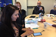 Founder of the Women�s CHAI Project, Najma Khalid, is shown how to use the AF detection devices with Health Innovation Manchester