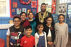 The Mayor of Oldham, dressed as Mr T, with pupils at Clarksfield Primary