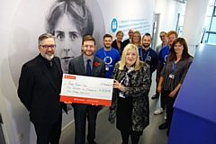 Oldham College students and staff hand over a �1,250 cheque to MP Jim McMahon