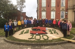 Local children stood by the flower bed outside Chadderton Town Hall