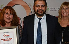 Majid Hussain, pictured (centre) at the 2016 Pride in Oldham Awards event