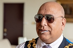 The Mayor of Oldham, Councillor Javid Iqbal, copies Kojak.
