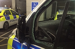 A police car was attacked with an axe in the robbery in Oldham