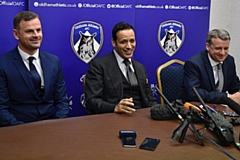 Low profile: Athletic's Moroccan owner Abdallah Lemsagam pictured (centre) at his unveiling in January. Then manager Richie Wellens (left) and then chief executive Mark Moisley were soon shown the door.