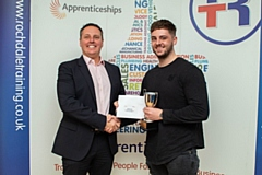 Oldham-based Brett Wardrope (right), of Hellermann Tyton, receives his Advanced Engineering Level 3 award