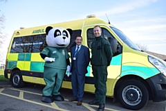 North West Ambulance Charity development manager, Vincent Sherard-Bornshin (centre), with Pandamedic (left) and David McNally, Community Engagement and Resuscitation Manager at North West Ambulance Service