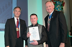 Stuart Smith (centre) receives his plastering award