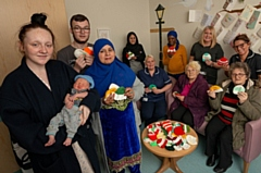 Pictured are baby Reece, mum Stacey Donaldson and dad Dylan Taylor, Hospital staff Melanie Wildman, Lead Midwife at the Labour Ward and Penny McDermott, Ward Manager of the Post-Natal Ward. The ladies from the Knit and Knatter group are Michelle McGahey, Nasra Hampshire, Carol Taylor and Toyibat Ganiyu