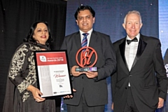 Oldham's Dr Zahid Chauhan (centre) receives his Homeless Friendly award
