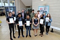 Thirteen top performing Oldham Sixth Form College students have each won a £500 scholarship to study at the London Institute of Banking and Finance.