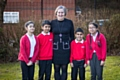 Roundthorn Primary Executive Primary School Executive Principal Lisa Needham with some of her happy pupils