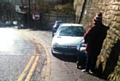 A post from the GMP Saddleworth and Lees Facebook page included a picture of a woman with a pram struggling to pass a parked car near Greenfield station