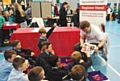 Year 5 children listen at the MPLOY Youth stall