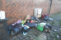 Fly-tipping waste to the rear of Mayfield Road in Oldham