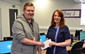 Rochdale Ear Clinic owner, Kath Scully, presents Kieran Cullinan with a gift reward for his website design