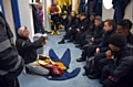Students are shown how to deal with a potential drowning situation by a member of the RNLI Lifeboat team