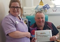 Royal Oldham Hospital Health Care Assistant Lesley Noon with patient Philip Hargreaves