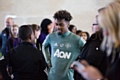 Manchester United prospect Angel Gomes meets some of the pupils at the Aon Training Complex