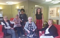 MP Debbie Abrahams with staff and residents at Springlees Court in Springhead