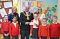 The Mayor of Oldham, Councillor Shadab Qumer, visited Knowsley Primary School to collect a cheque for �100  Children pictured are (left to right): Alicia Harrop, Sumayyah Alyas, Maisie Comer (Chair of the School Council - presenting the cheque), Joseph Baines and Finley Hampshire. The adults are (left to right): Miss Vanessa Payne (Headteacher) and Mrs Asia Anderson (Charities Co-ordinator and Year 4 teacher).
