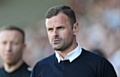 Athletic manager Richie Wellens on the touchline at the Sixfields Stadium