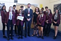 MP Jim McMahon with pupils at Hathershaw College