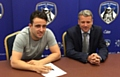 Jose Baxter signs on the dotted line