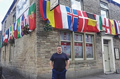 Mark Howard outside his flag-draped Top House pub in Lees