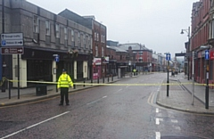 The cordoned-off scene on Yorkshire Street this morning