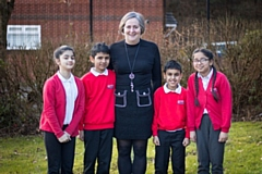 Roundthorn Primary School Executive Principal Lisa Needham with some of her happy pupils