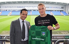 New Athletic loan 'keeper Daniel Iversen pictured with club owner Abdallah Lemsagam
