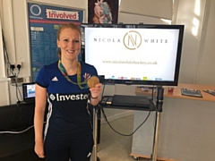 Nicola White shows off her Olympic Gold medal at Oldham College