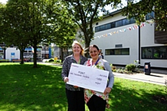 POINT collects the cheque from Oldham College