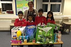 Umar, Muhammed Ali, Alishba and Ayaan with some of the Foodbank offerings