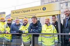 KeolisAmey Customer Service Representatives (yellow jackets) with (left to right) Danny Vaughan � TfGM�s Head of Metrolink, Greater Manchester Mayor Andy Burnham, Stephen Rhodes � TfGM�s Customer Director and Rob Cox � Director of Service Delivery at KeolisAmey Metrolink