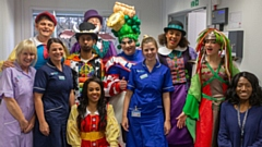 The cast of Jack and the Beanstalk with staff at Dr Kershaw's Hospice