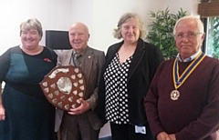 Our picture shows Rotary President Colin Platt presenting the award to this year's winner - Christies Oldham - to Julie Davies and Helen Murphy from the clinic, with Rotary Community Service chairman Ray Coverley