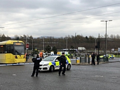 Police at the scene of Oldham Mumps, where a woman was hit by a tram on Wednesday.