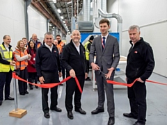 Cllr Sean Fielding, centre, cutting the ribbon at HPP�s new vinyl-wrapped door production line with, from left, Richard Mottram, Keith Wardrope and Stephen Hill, all from HPP.