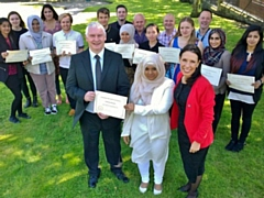 Tahmina, along with the other participants of a previous summer school, being awarded their �graduation� certificates by special guest Bryn Hughes, father of the late PC Nicola Hughes, and Debbie